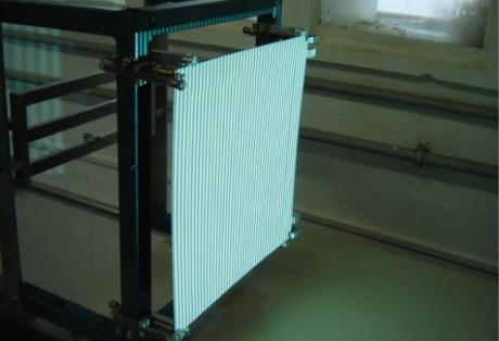 Medição óptica da fluência em materiais compósitos sob carregamento